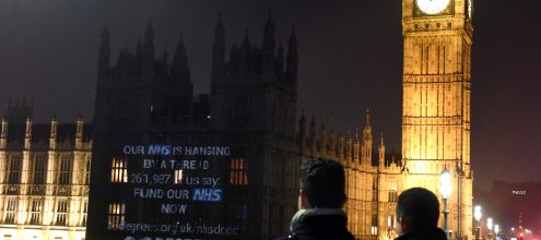 NHS documentary projected on parliament
