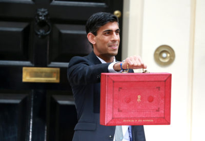 Rishi Sunak holds up a red briefcase outside number 11 Downing Street